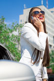 Beautiful young businesswoman using cell phone Royalty Free Stock Images