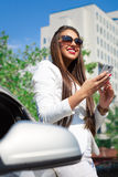 Beautiful young businesswoman using cell phone Stock Photography