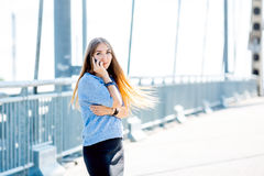 Beautiful happy young businesswoman using cell phone on city street. Beautiful young businesswoman using cell phone on city street royalty free stock photos