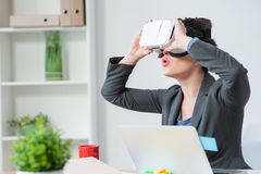 Beautiful young businesswoman is using eyewear device Royalty Free Stock Image