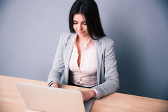 Beautiful young businesswoman using laptop Royalty Free Stock Images