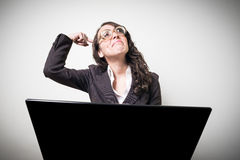 Beautiful young businesswoman using notebook Royalty Free Stock Photography