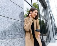Beautiful young businesswoman wearing autumn coat stock images