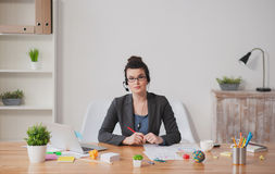 Beautiful young businesswoman is working with calls Stock Images