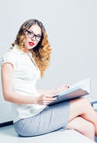 Beautiful young businesswoman working with documents Royalty Free Stock Photo