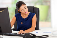 Businesswoman working office Stock Image