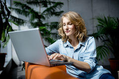 Beautiful young businesswoman working with laptop Stock Images