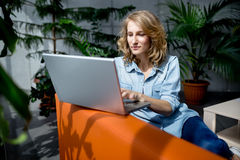 Beautiful young businesswoman working with laptop Stock Photo