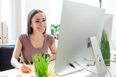 Beautiful young businesswoman is working in office Royalty Free Stock Image