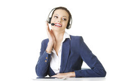 Beautiful young call-center assistant at the desk Stock Photos
