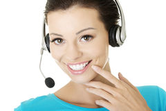 Beautiful young call-center assistant smiling Royalty Free Stock Images