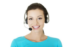 Beautiful young call-center assistant smiling Stock Photo