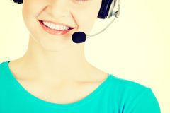 Beautiful young call-center assistant smiling Stock Photos