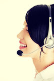 Beautiful young call-center assistant smiling Royalty Free Stock Photography