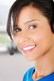 Beautiful young call-center assistant smiling Stock Image