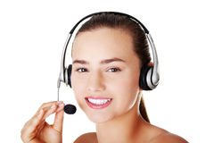 Beautiful young call-center assistant smiling Royalty Free Stock Image