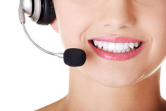 Beautiful young call-center assistant smiling Stock Photography