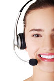 Beautiful young call-center assistant smiling Stock Images