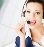 Beautiful young call-center assistant Stock Photo