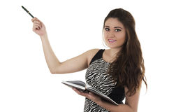 Beautiful young casual girl holding notebook Royalty Free Stock Image