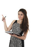 Beautiful young casual girl holding notebook Stock Image