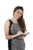 Beautiful young casual girl holding notebook Royalty Free Stock Images