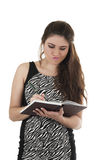 Beautiful young casual girl holding notebook Royalty Free Stock Photography