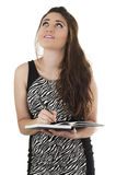 Beautiful young casual girl holding notebook Royalty Free Stock Photo
