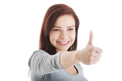 Beautiful young and casual girl is showing ok gesture. Stock Photos
