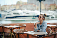 Beautiful young casual style woman sitting alone Stock Photo