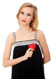 Beautiful young casual woman holding red heart Royalty Free Stock Photo