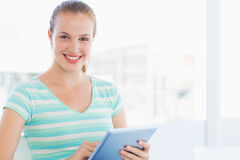 Beautiful young casual woman using digital tablet Royalty Free Stock Photos