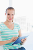Beautiful young casual woman using digital tablet Royalty Free Stock Images