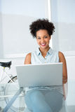 Beautiful young casual woman using laptop Royalty Free Stock Images