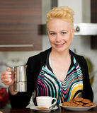Beautiful young caucasian blond woman cooking espresso coffee in Stock Photos