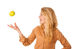 Beautiful young caucasian blonde woman eats a green apple as a s Royalty Free Stock Photo