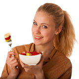 Beautiful young caucasian blonde woman holds a delicious fruit s Stock Photography