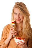 Beautiful young caucasian blonde woman holds a delicious fruit s Stock Photos