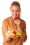 Beautiful young caucasian blonde woman holds a delicious fruit s Royalty Free Stock Photography