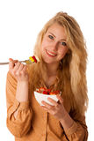 Beautiful young caucasian blonde woman holds a delicious fruit s Royalty Free Stock Image