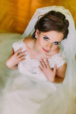 Beautiful young caucasian bride in gorgeous white dress photographed from above Stock Photography