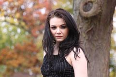 Beautiful young caucasian brunette outside in autumn Stock Photos
