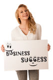 Beautiful young caucasian business woman holding a blank white b Royalty Free Stock Images