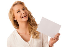 Beautiful young caucasian business woman holding a blank white b Royalty Free Stock Photos