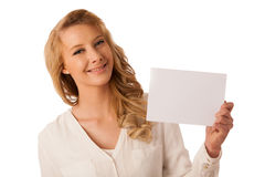 Beautiful young caucasian business woman holding a blank white b Stock Photo