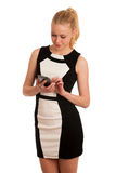 Beautiful young caucasian business woman with smartphone communi Royalty Free Stock Photo