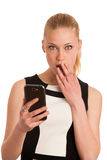 Beautiful young caucasian business woman with smartphone communi Royalty Free Stock Photos