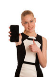 Beautiful young caucasian business woman with smartphone communi Royalty Free Stock Photography