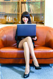 Beautiful young caucasian businesswoman working on laptop. Stock Photography