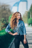 Beautiful young Caucasian girl with curly hair Royalty Free Stock Images